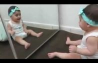 Cute Baby Playing With The Mirror