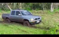SUV Helping A Car Stuck In Mud