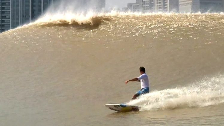 "Surfing China's River Wave – The ""Silver Dragon"""