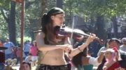 The Violinist Girl Performing On The Street